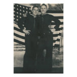 2 sailors front of flag poster