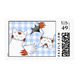 2 sides to a cat, good kitty and bad orange tabby postage stamp