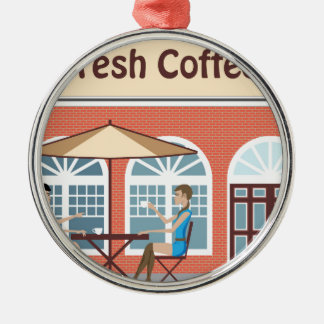 2 Women drinking coffee at a cafe outside Metal Ornament
