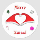 2 Xmas hats form a heart and other decorations Classic Round Sticker