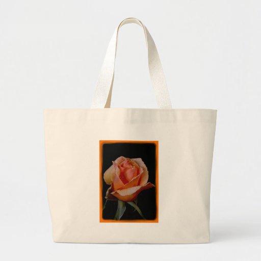 3 color de rosa anaranjados bolsas de mano