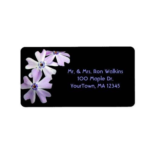 3 flores púrpuras etiqueta de dirección