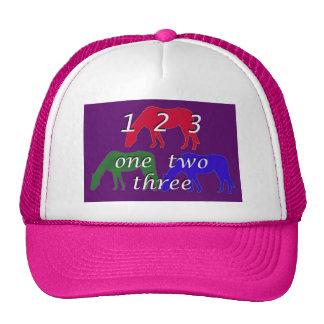 3 horses in 3 horse colors on dark purple backgrou hat