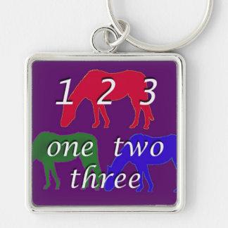 3 horses in 3 horse colors on dark purple backgrou key chain