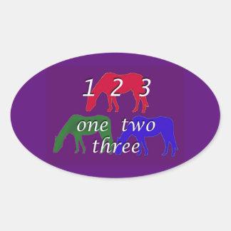 3 horses in 3 horse colors on dark purple backgrou oval sticker