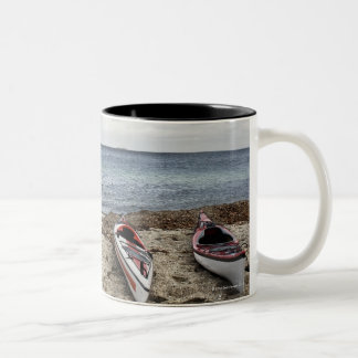 3 kayaks on beach Two-Tone coffee mug