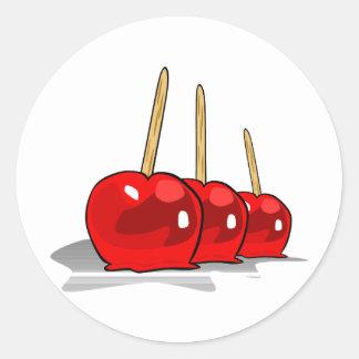 3 manzanas de caramelo rojas etiqueta redonda