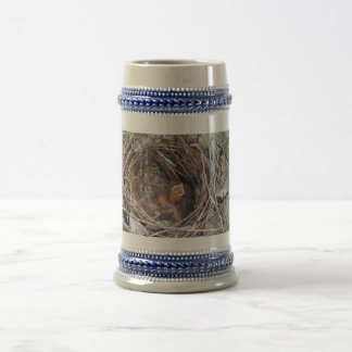 3 new born baby birds in a nest with do not remove beer stein
