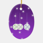3 White Christmas Baubles on Purple Background. Christmas Tree Ornaments