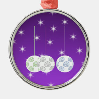 3 White Swirl Design Christmas Baubles. On Purple Metal Ornament