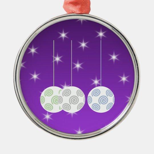 3 White Swirl Design Christmas Baubles. On Purple Metal Ornament
