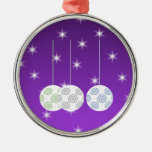 3 White Swirl Design Christmas Baubles. On Purple Christmas Ornament