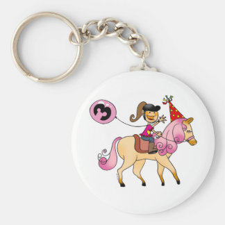 3 year old girl on a pony keychain