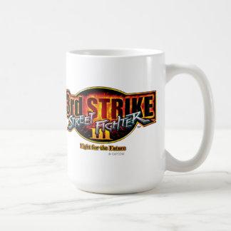 3ro logotipo de la huelga de Street Fighter III Tazas