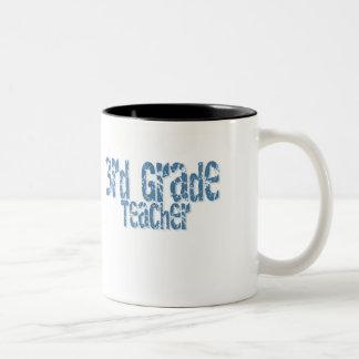 3ro profesor apenado azul del grado del texto taza de dos tonos