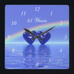 """45th Anniversary Sapphire Hearts Square Wall Clock<br><div class=""""desc"""">A pretty 3d image of sapphire hearts floating on the water under a rainbow with customizable text that says &quot;45 Years&quot;.</div>"""