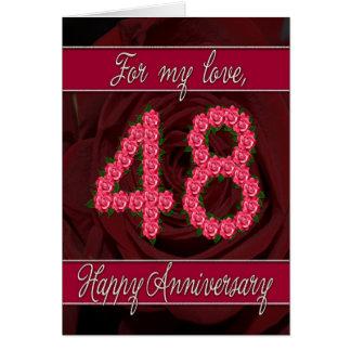 48 a tarjeta del aniversario con los rosas y las h