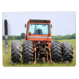 4 Tires On An Old Tractor Sitting In A Field Dry-Erase Whiteboards