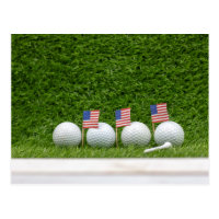 4th July golf ball with flag of America on green Postcard