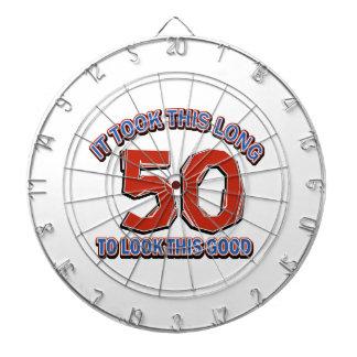 50th birthday design dartboard with darts