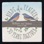 """50th Wedding Anniversary, Bluebirds of a Feather Stone Coaster<br><div class=""""desc"""">Birdwatchers will adore this custom 50th wedding anniversary keepsake! A male and female bluebird perching on a leafy tree branch are surrounded by handwritten text that reads, """"Birds of a Feather, 50 Years Together. Two names and a wedding date are featured near the center and can be personalized. Perfect for...</div>"""