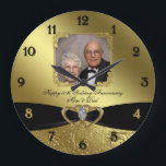 "50th Wedding Anniversary Photo Wall Clock<br><div class=""desc"">A Digitalbcon Images Design featuring a black satin and gold color and flourish design theme with a variety of custom images, shapes, patterns, styles and fonts in this one-of-a-kind &quot;Golden Wedding Anniversary Design&quot; Photo Wall Clock. With this attractive and elegant design choice you&#39;ll have all your decorations, gift ideas and...</div>"