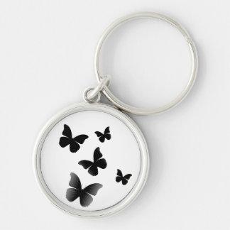 5 mariposas negras llavero redondo plateado