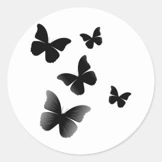 5 mariposas negras pegatina redonda