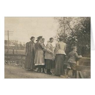 5 people overlooking bridge card