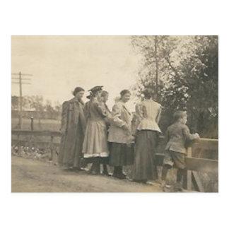 5 people overlooking bridge post card