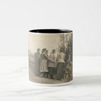 5 people overlooking bridge Two-Tone coffee mug