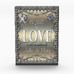 """60 Years of Love Award<br><div class=""""desc"""">A scrollwork frame holds the text &#39;60 years of love and marriage&#39; and a template to enter the first names of the celebrating couple. The text is set off by images of two sparkling  diamonds on a pale gradient background.</div>"""