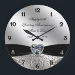 "60th Diamond Wedding Anniversary Round Wall Clock<br><div class=""desc"">A Digitalbcon Images Design featuring a platinum silver and black color and flourish design theme with a variety of custom images, shapes, patterns, styles and fonts in this one-of-a-kind &quot;60th Diamond Wedding Anniversary&quot; Round Wall Clock. This elegant and attractive design comes complete with customizable text lettering to suit your own...</div>"