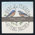 "60th Wedding Anniversary, Bluebirds of a Feather Stone Coaster<br><div class=""desc"">Birdwatchers will adore this custom 60th wedding anniversary keepsake! A male and female bluebird perching on a leafy tree branch are surrounded by handwritten text that reads, ""Birds of a Feather, 60 Years Together. Two names and a wedding date are featured near the center and can be personalized. Perfect for...</div>"