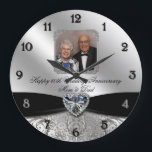 "60th Wedding Anniversary Round Photo Wall Clock<br><div class=""desc"">A Digitalbcon Images Design featuring a black satin and platinum silver color and flourish design theme with a variety of custom images, shapes, patterns, styles and fonts in this one-of-a-kind &quot;Diamond Wedding Anniversary Design&quot; Photo Wall Clock. With this attractive and elegant design choice you&#39;ll have all your decorations, gift ideas...</div>"