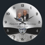 """60th Wedding Anniversary Round Photo Wall Clock<br><div class=""""desc"""">A Digitalbcon Images Design featuring a black satin and platinum silver color and flourish design theme with a variety of custom images, shapes, patterns, styles and fonts in this one-of-a-kind &quot;Diamond Wedding Anniversary Design&quot; Photo Wall Clock. With this attractive and elegant design choice you&#39;ll have all your decorations, gift ideas...</div>"""