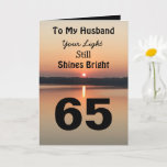 """65th Birthday Husband Still Shines Bright Card<br><div class=""""desc"""">Give a happy 65th birthday card to your husband to express your """"You Still Shine Bright"""" sentiment. A bold design with a black and gold sunrise on a peaceful lake sends a message of encouragement and love. Read inside the card for an endearing birthday verse for an inspiring sixty-fifth birthday...</div>"""