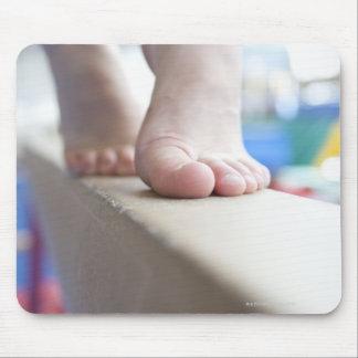 6-7 year old girl slowly walks across balance mouse pad