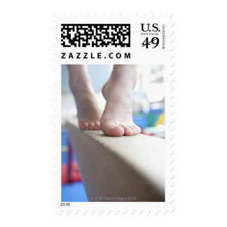 6-7 year old girl slowly walks across balance postage stamps