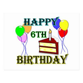 6to cumpleaños feliz con la torta, los globos y la tarjetas postales