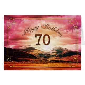 70 cumpleaños puesta del sol sobre las montañas tarjeta