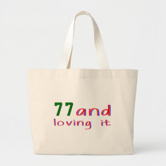 77 and loving it tote bags