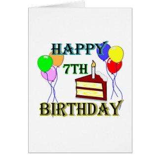7mo cumpleaños feliz con la torta, los globos y la tarjeta de felicitación