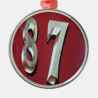 87 en oro adorno navideño redondo de metal