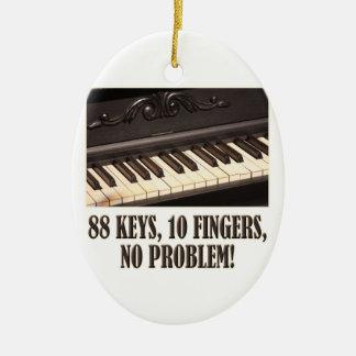 ¡88 llaves, 10 dedos, ningún problema! adorno navideño ovalado de cerámica