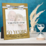 "8x10 Golden 50th Wedding Anniversary Photo Frame<br><div class=""desc"">Lovely gift for the golden anniversary couple. Add a recent photo or wedding photo,  their names and the date of their 50th Wedding Anniversary. Done in an elegant gold print and silver bow,  the colors for a golden wedding anniversary. Great anniversary gift. Also available as a 5x7.</div>"