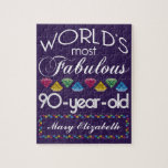 "90th Birthday Most Fabulous Colorful Gems Purple Jigsaw Puzzle<br><div class=""desc"">Celebrate the milestone birthday of your favorite senior citizen with this fun gift reminding them of how fabulous they are. White and grey lettering on deep purple background. Colorful diamonds in rainbow tones serve as accent. Customize with names, initials or other text. This series is in increments of 5 years...</div>"