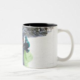 9 years old girl snowboarding Two-Tone coffee mug