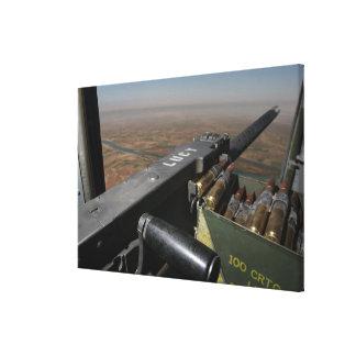A 50 caliber machine gun stretched canvas prints