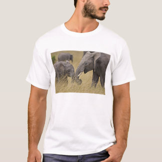 A African Elephant grazing in the fields of the T-Shirt